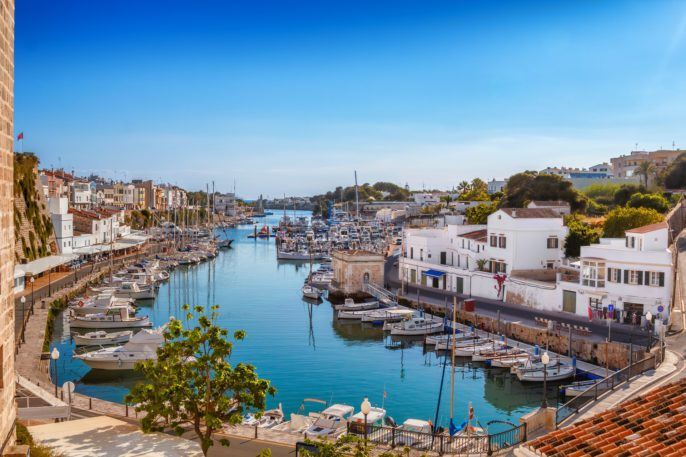 Menorca View on old town Ciutadella sea port on sunny day shutterstock_554710495