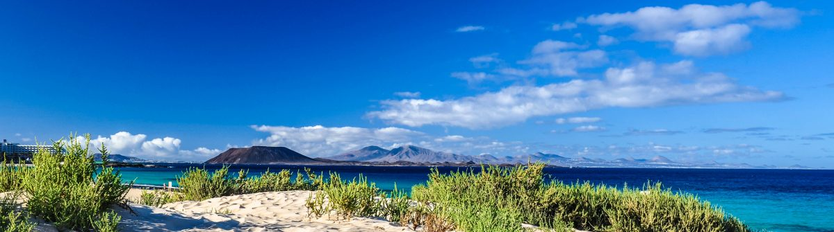Lobos and Lanzarote seen from Corralejo Beach, Fuerteventura iStock_000048832316_Large-2