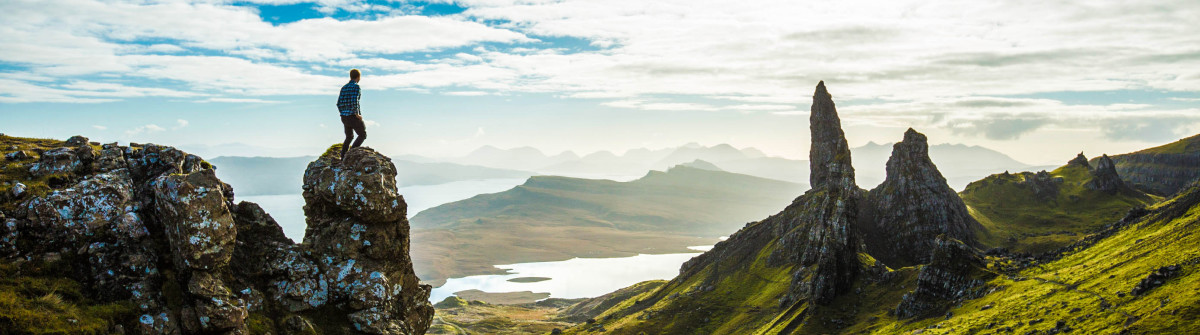 Hiker looking at view of Scottish highland cliffs Skye iStock_000061488168_Large-2