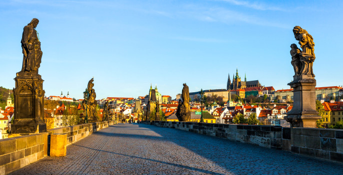 Panorama of Charles bridge and Prague castle in the early morning. Prague, Czech Republic shutterstock_321989693-2
