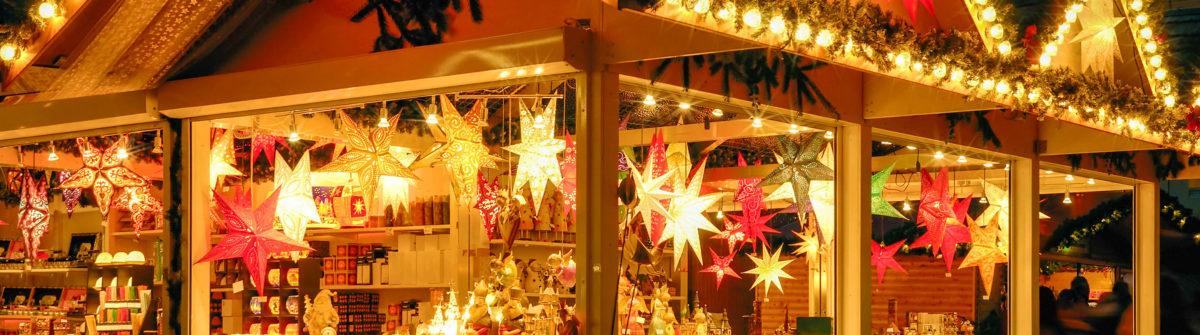 illuminated-christmas-fair-kiosk-with-loads-of-shining-decoration-merchandise-shutterstock_157503014-2