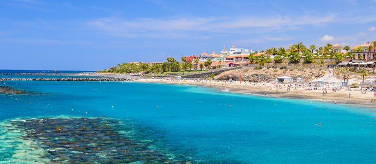 beautiful-turquoise-sea-water-on-el-duque-beach-tenerife-canary-islands-spain_shutterstock_215402416