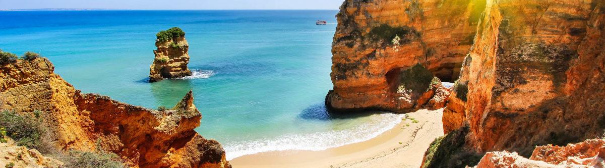 rocky-beach-at-sunset-lagos-portugal-shutterstock_289549745-2