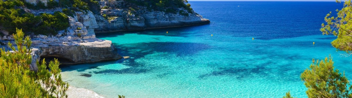 secluded-beach-with-turquoise-sea-water-cala-mitjaneta-menorca-island-spain-shutterstock_189270002