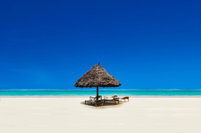 Straw hut on an idyllic beach