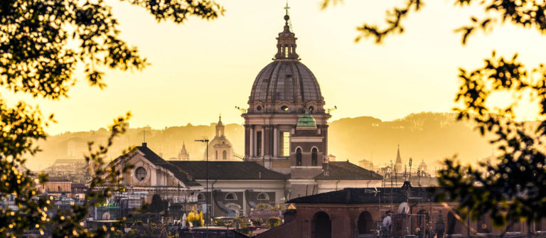 Rome skyline with church cupolas at sunset Italy iStock_000081822635_Large-2