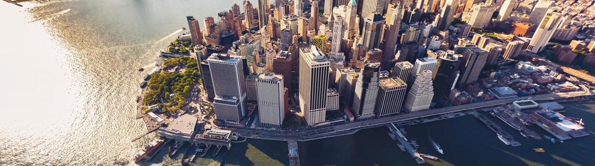 aerial-view-of-lower-manhattan-new-york-city-istock_103394967_xlarge-1-1200×335