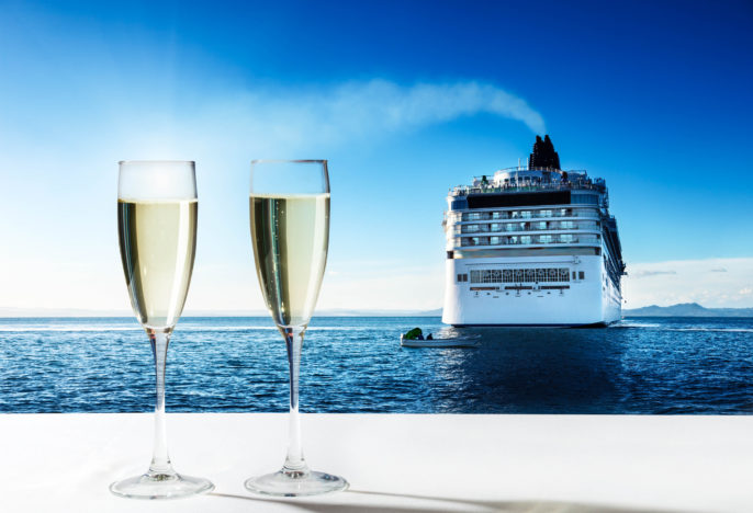 champaign Glasses and cruise ship shutterstock_162213275-2