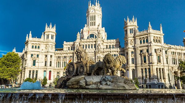Cibeles fountain at Plaza de Cibeles in Madrid in a beautiful summer day, Spain_shutterstock_340634714_pix600