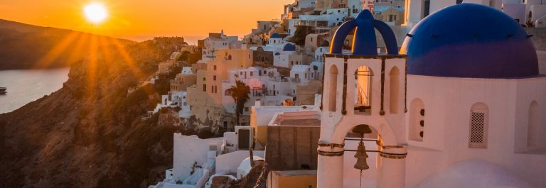 Sunset in Oia Santorin Greece shutterstock_541645051