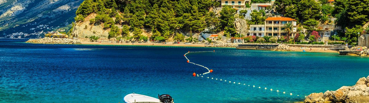 Beautiful coastline and beach with motorboat,Brela,Dalmatia regi