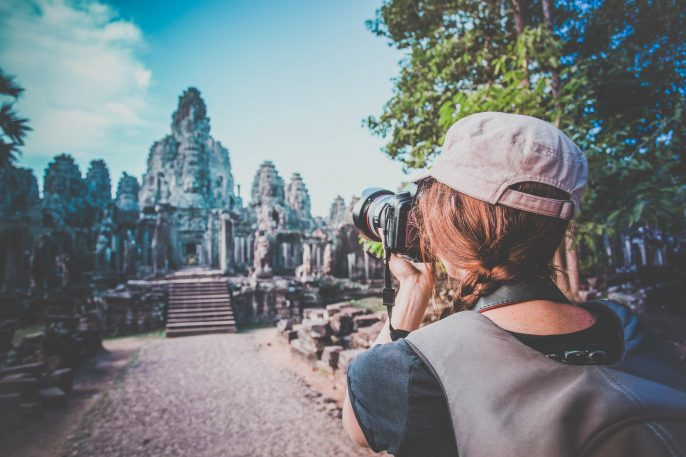 Woman Photographer Taking Picture at Angkor Wat, Cambodia