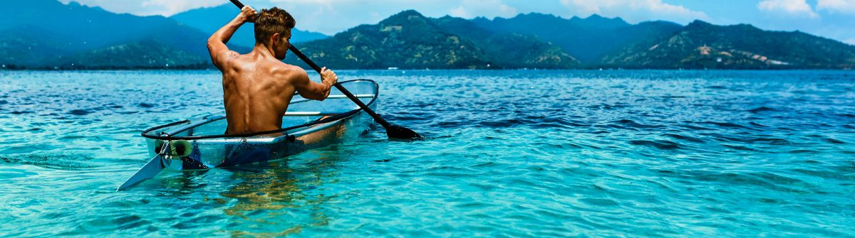 Summer Travel Kayaking. Man Canoeing Transparent Kayak In Ocean