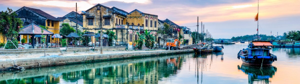 Boat and buildings reflection in morning, Hoi An, Vietnam