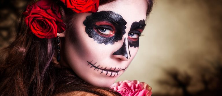 attractive young woman with sugar skull makeup shutterstock_209736142-2