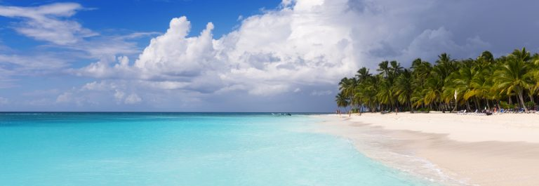 Beach on the tropical island. Clear blue water, sand and palm trees. Beautiful vacation spot, treatment and aquatics. - Copy