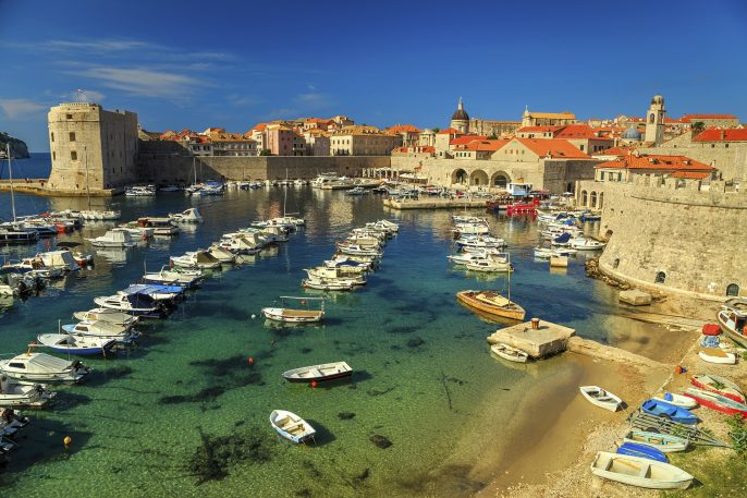 Old city of Dubrovnik panorama with colorful boats,Croatia,Europe