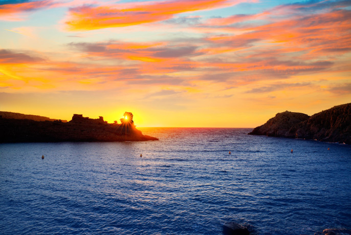 Menorca sunset in Cala Morell at Ses torretes beach