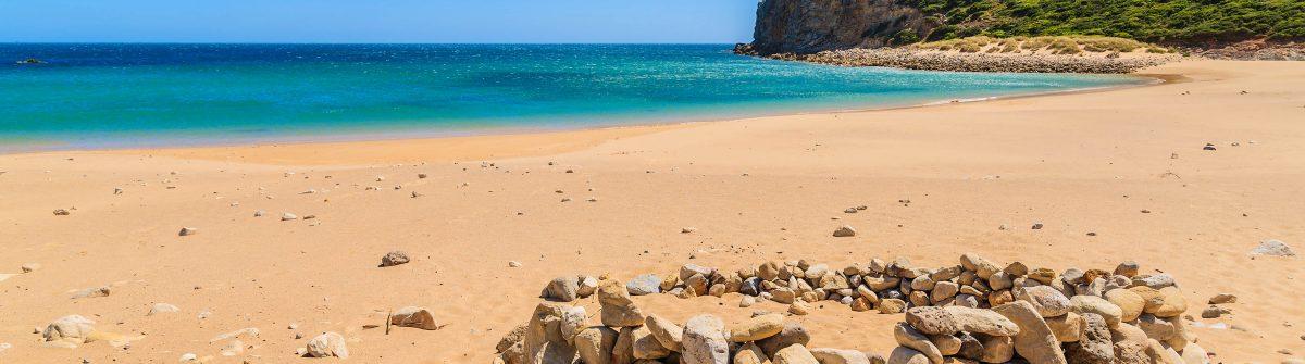 Golden sand Praia do Barranco beach, Algarve region, Portugal shutterstock_280694528-2