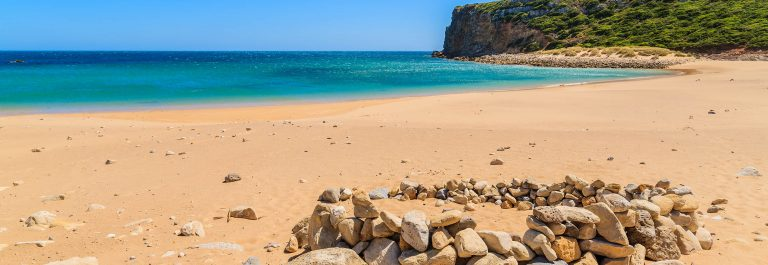 Golden sand Praia do Barranco beach, Algarve region, Portugal shutterstock_280694528-2
