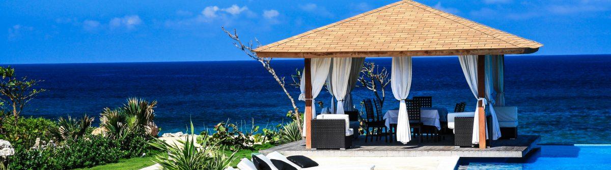 Luxury summerhouse with swimming pool on Atlantic ocean beach shutterstock_67081069-2