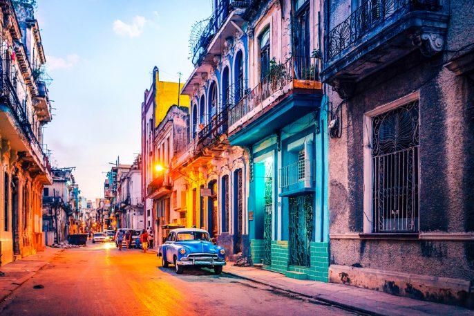 Old American car on street at dusk Havana Cuba iStock_000068527767_Large-2