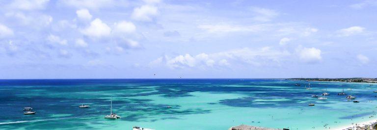 Sun on the beach in Aruba iStock_000034147572_Large-2
