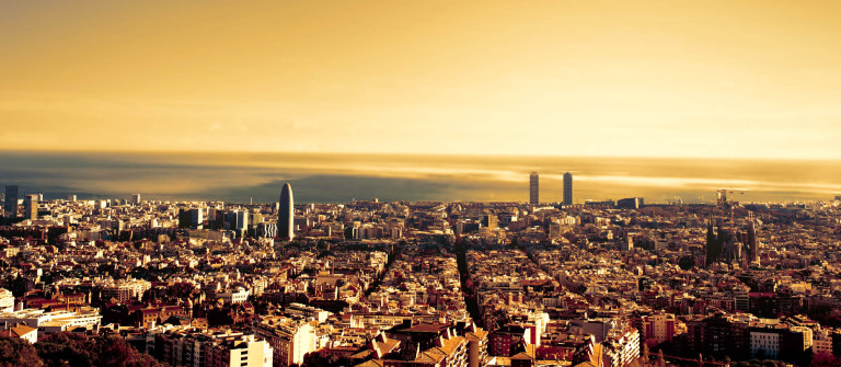 Barcelona – a bird view over city. Catalonia, Spain. Night, sunset