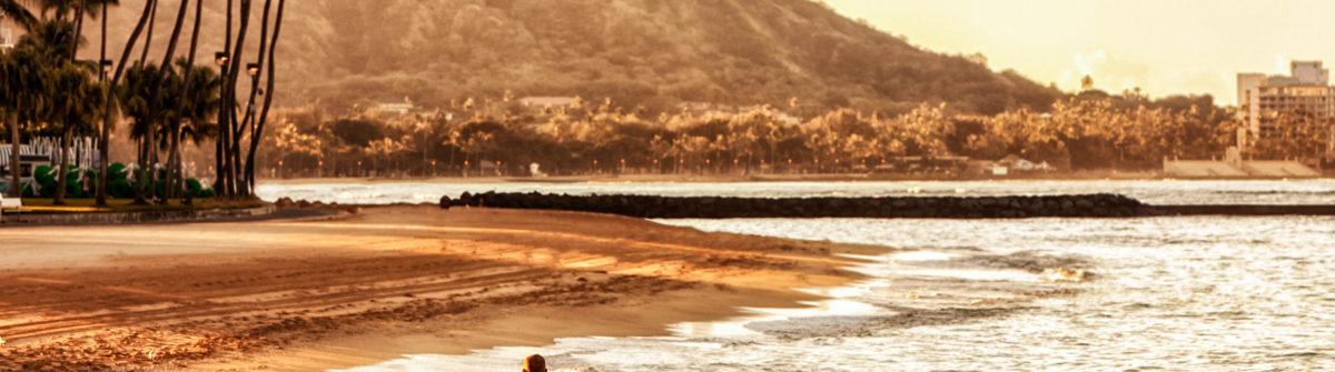 Happy Couple Walking on Waikiki Beach at Sunrise