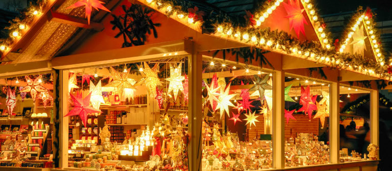 illuminated-christmas-fair-kiosk-with-loads-of-shining-decoration-merchandise-shutterstock_157503014-2