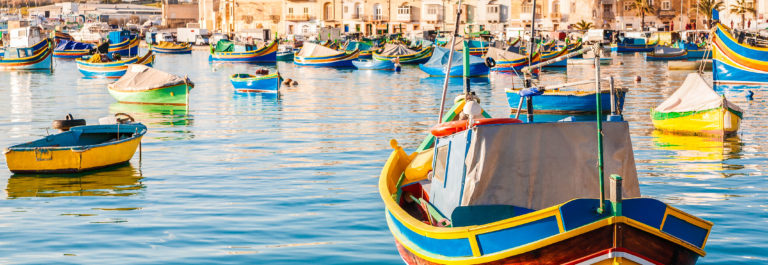 mediterranean-traditional-colorful-boats-luzzu-shutterstock_274378319-2